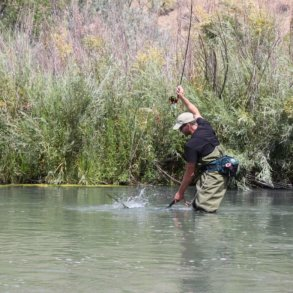 This best fishing waders image shows fishing waders in action on the river.