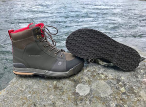 This best wading boot photo shows the Redington Prowler wading boots on a rock near a river.