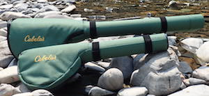 This fly fishing gift guide image shows a double Cabela's fly rod case and a single fly rod case on the bank of a river.