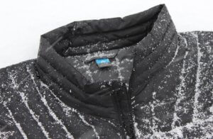 this best down jacket image shows snow on the dwr waterproofing coating on an Eddie Bauer down jacket.
