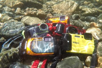 This image shows five of the best waterproof cameras underwater.