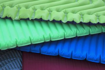 This image shows several sleeping pads good for backpacking or camping.