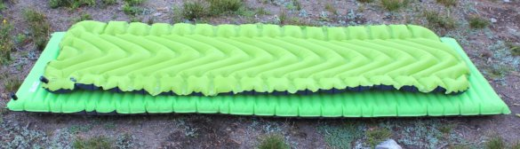 This photo shows two of the best sleeping pads for backpacking and camping, the Static V2 and NeoAir mattress.