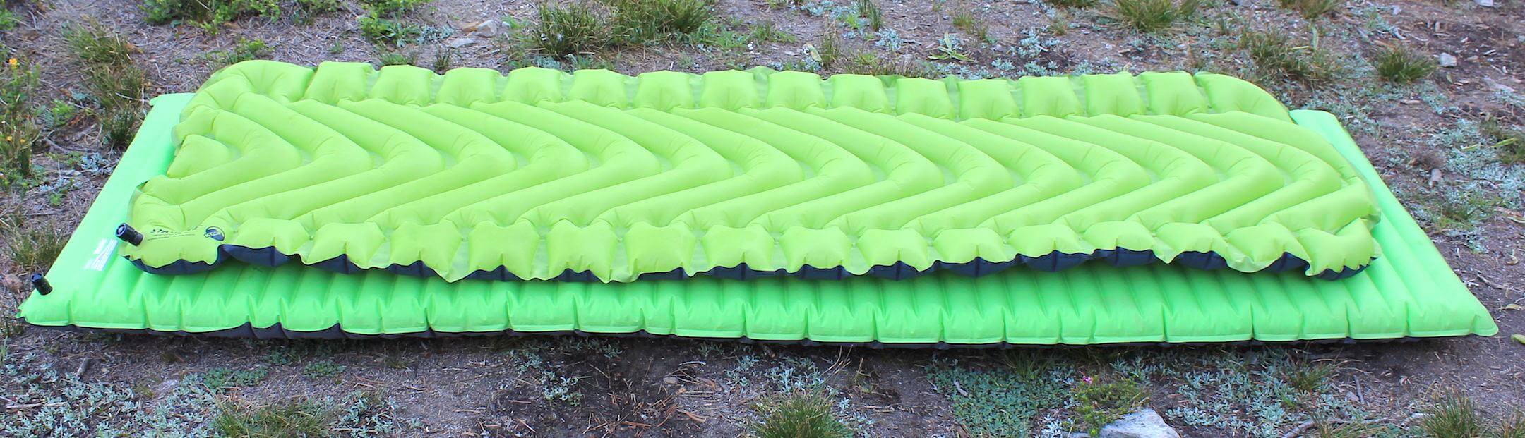 This image shows two of the best sleeping pads for backpacking and camping,  the Static