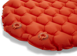 The best sleeping pads image shows the REI Flash Insulated Air Pad inflation and deflation valves.