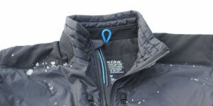 This image shows the KÜHL FIREFLY jacket front with some snow.