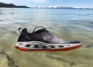 This best water shoe image shows the Columbia Drainmaker III floating in the water at Lake Tahoe.