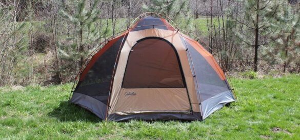 This image shows the Cabela's West Wind Dome Tent 6-person version outside without a rainfly.