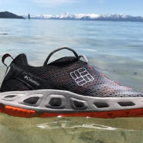 This image shows the Columbia Drainmaker III water shoe floating in Lake Tahoe.
