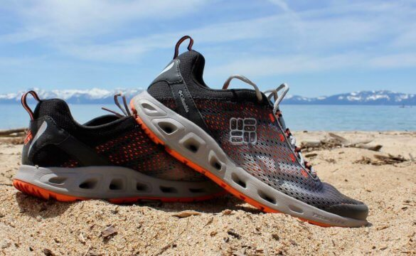 This image shoes the Columbia Drainmaker III water shoe on a sandy beach.