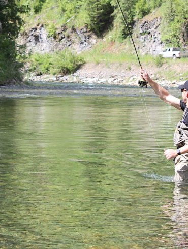 This Orvis Silver Sonic Convertible-Top Waders review photo shows a fly fisher wearing the Orvis waders in a river.
