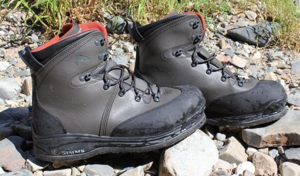 This image shows the Simms Freestone Boot Felt on the banks of a river.