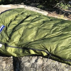 This image shows the Feathered Friends Flicker 20 Nano Down Quilt Sleeping Bag in the Eagle Cap Wilderness area.