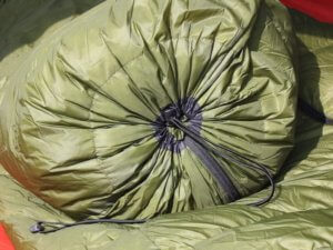 This image shows the Feathered Friends Flicker 20 Nano down quilt sleeping bag footbox closed.