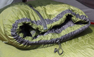 This image shows the Feathered Friends Flicker down quilt sleeping bag footbox.