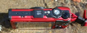 This Olympus Tough TG-5 camera review photo shows the top of the TG-5.