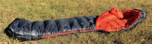 This image shows the REI Co-op Magma 10 Sleeping Bag in the Eagle Cap Wilderness on the ground.