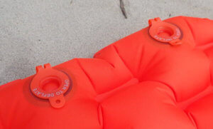 This image shows the valves on the REI Co-op Flash Insulated Air Sleeping Pad.
