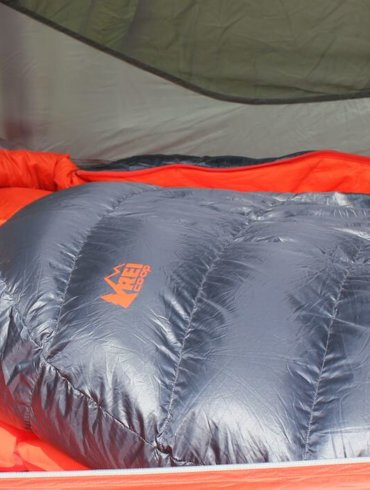 This image shows the REI Co-op Magma 10 Sleeping bag in a tent.