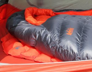 This image shows the Flash Insulated Air Sleeping Pad in a tent with an REI magma sleeping bag on top of the pad.