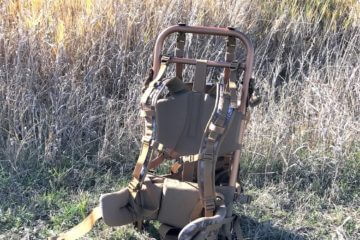 This image shows the SJK Rail Hauler 2.0 backpack in a field.