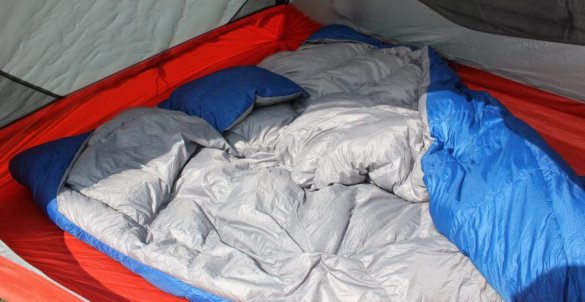 This photo shows the Sierra Design Backcountry Quilt 700 inside of a tent.