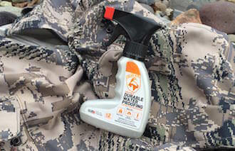 This hunting gift guide image shows Gear Aid ReviveX on camouflage pants.