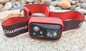 This backpacking gift idea photo shows the Black Diamond Spot Headlamp.