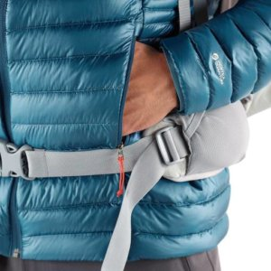 This image shows the REI Co-op Magma 850 down jacket pockets in a closeup with a backpacking hip belt.
