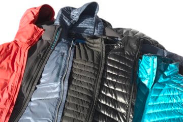 This photos shows multiple best down jackets together including the REI Co-op Magma 850 Down Jacket, Eddie Bauer MicroTherm StormDown Jacket, KUHL Spyfire Down Jacket and more.