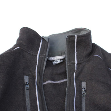This photo shows the top half of the KÜHL INTERCEPTR jacket on white snow background.