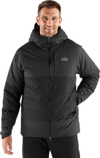 This photo shows a man wearing the men's REI Stormhenge 850 Down Jacket.