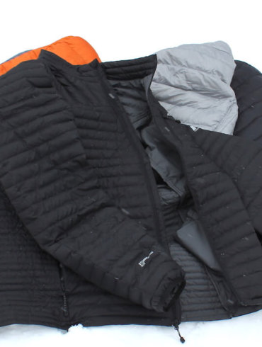 This image shows several down jackets, including an XL Tall Eddie Bauer DownLight StormDown Jacket.