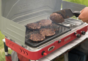 This photo shows the Camp Chef Rainier Campers Combo portable camping stove and grill.