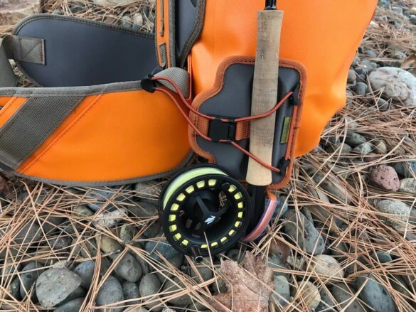 This photo shows the Fishpond Quickshot Rod Holder accessory attached to a Fishpond waterproof backpack.