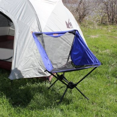 This camp chair photo shows the REI Co-op Flexlite Macro Chair in front of a tent.