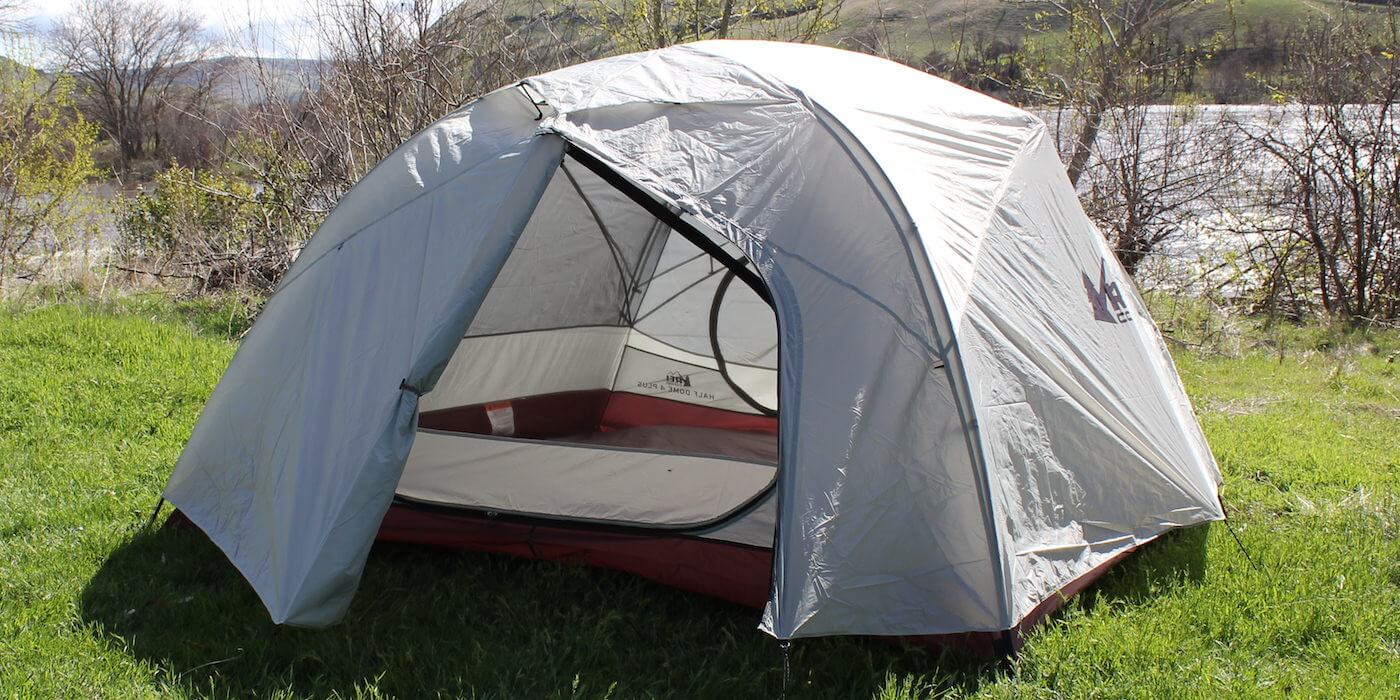 This photo shows the REI Co-op Half Dome 4 Plus Tent with one door open.
