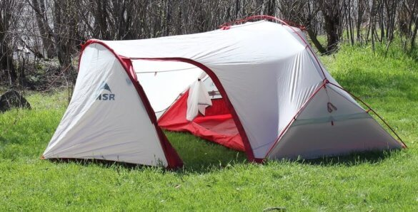 This photo shows the MSR Hubba Tour 2 Tent setup outside on a sunny day.