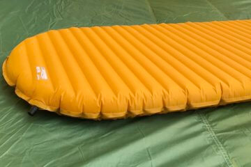 This photo shows the Therm-a-Rest NeoAir XLite air mattress backpacking sleeping pad on a tent floor.