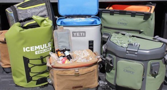 This photo shows YETI, ICEMULE, OtterBox, Coleman, and Fishpond soft-sided coolers next to each other with ice.