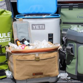 This photo shows several soft-sided coolers next to each other, including the YETI Hopper Backflip 24, OtterBox Trooper 20, Fishpond IceStorm, Fishpond Blizzard, and ICEMULE Pro soft coolers.