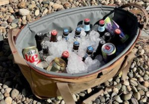 This photo shows the Fishpond Ice Storm soft-sided cooler loaded with ice and beverages.