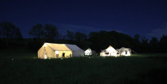 This photo shows turkey camp at night with outfitter tents from Cabela's.