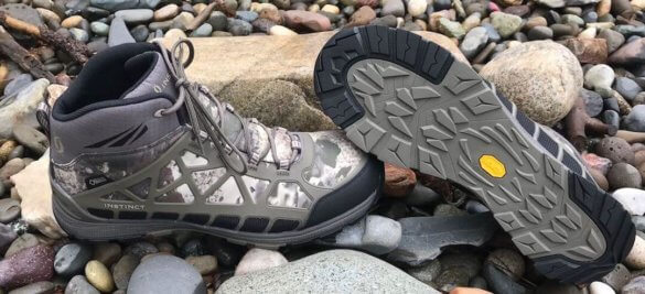 This photo shows the Cabela's Instinct Pursuitz hunting boots on rocks.