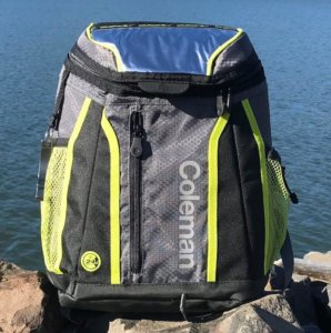 This photo shows the affordable Coleman Maverick Ultra Backpack Cooler near a lake.