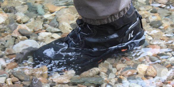 This photo shows the Korkers Devil's Canyon wading boot in water.