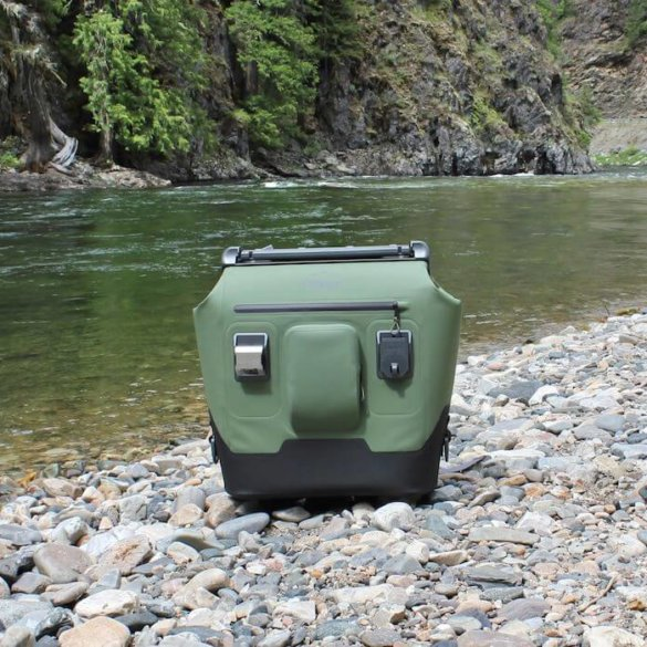 This photo shows the OtterBox Trooper LT 30 next to a river.
