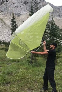 This photo shows the author holding the Big Agnes Fly Creek HV2 Platinum Tent up in the air.