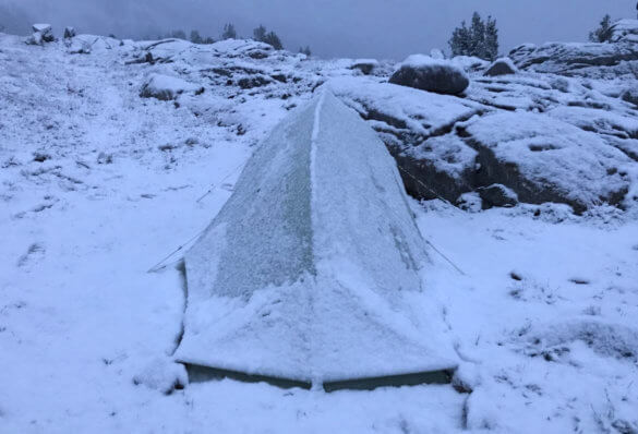 This photo shows the Big Agnes Fly Creek HV2 Platinum Tent with snow on it.