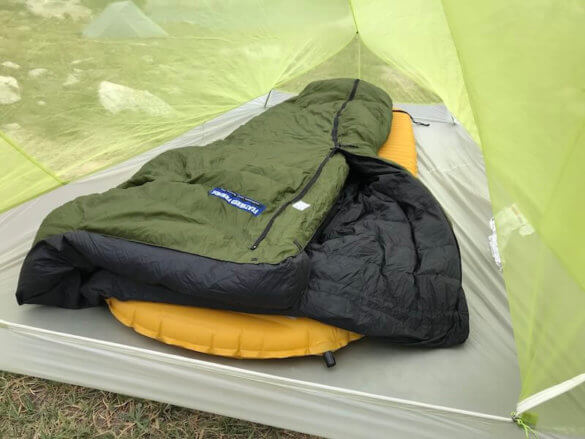 This photo shows the Big Agnes Fly Creek HV2 Platinum Tent interior with a backpacking sleeping pad and down sleeping bag.